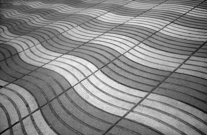 Paved sidewalk. Background of paved sidewalk in grayscale stock image