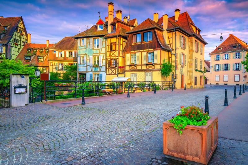 Paved street and medieval half timbered facades in Colmar, France royalty free stock photos