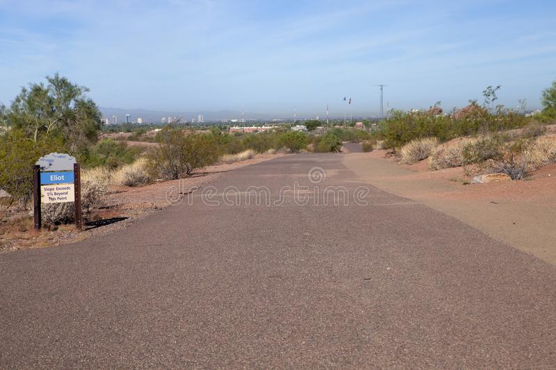 The paved trail at the park in Arizona. The paved Eliot trail at Papago Park in Phoenix Arizona stock image