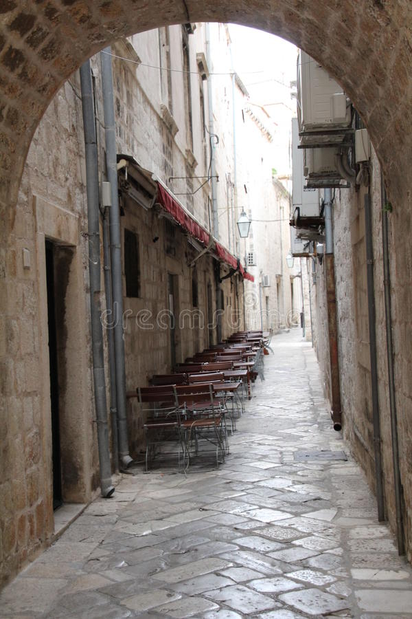 Pavement Cafe. Outside seating in Dubrovnik old town. There are many of these pavement cafes in the narrow streets of the walled citadel royalty free stock photography