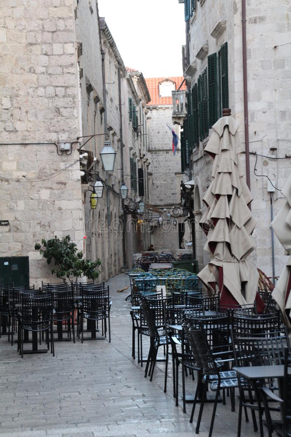 Pavement Cafe. Outside seating in Dubrovnik old town. There are many of these pavement cafes in the narrow streets of the walled citadel royalty free stock photos