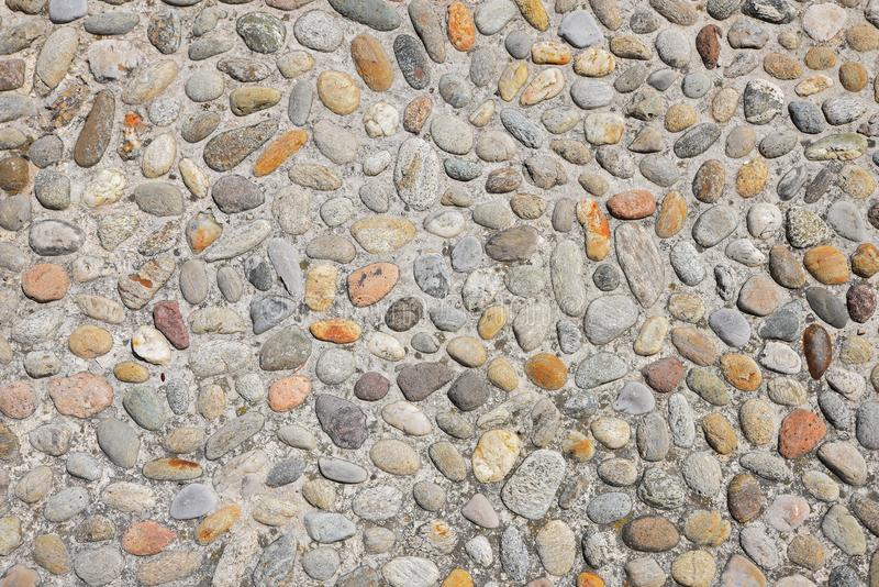 Pavement with colorful cobblestones and concrete royalty free stock photos