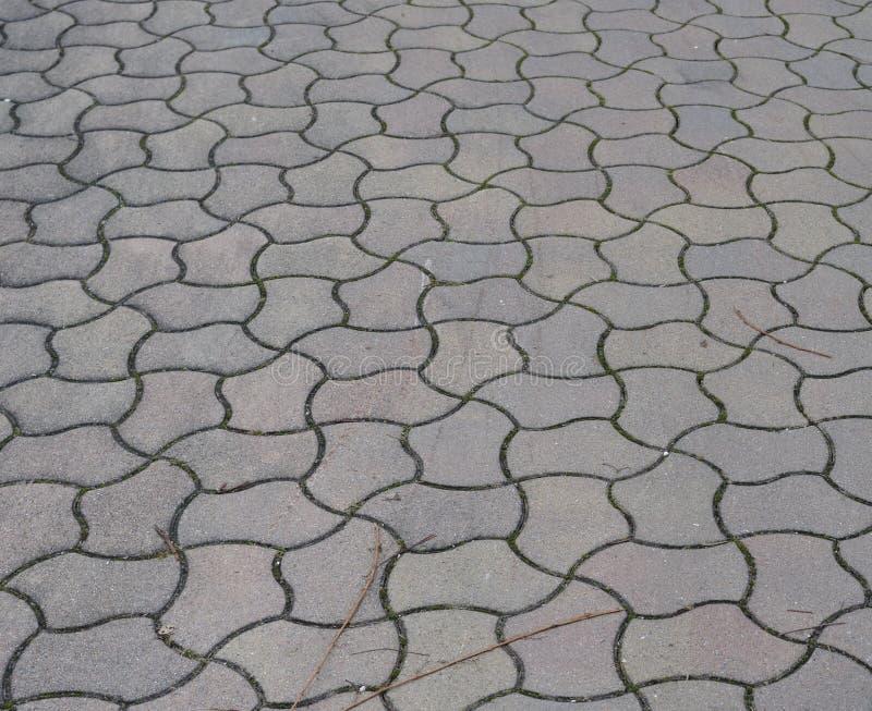 Pavement of concrete blocks in jigsaw pattern stock image