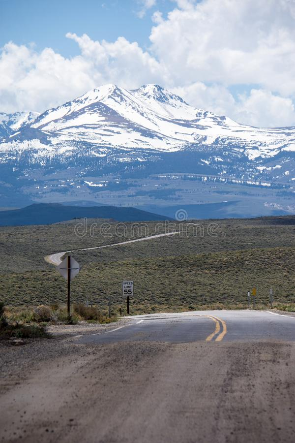 The pavement ends and the dirt road begins on California State Highway 270 near Bodie Ghost Town in the Eastern Sierra Nevada. Mountains royalty free stock photography