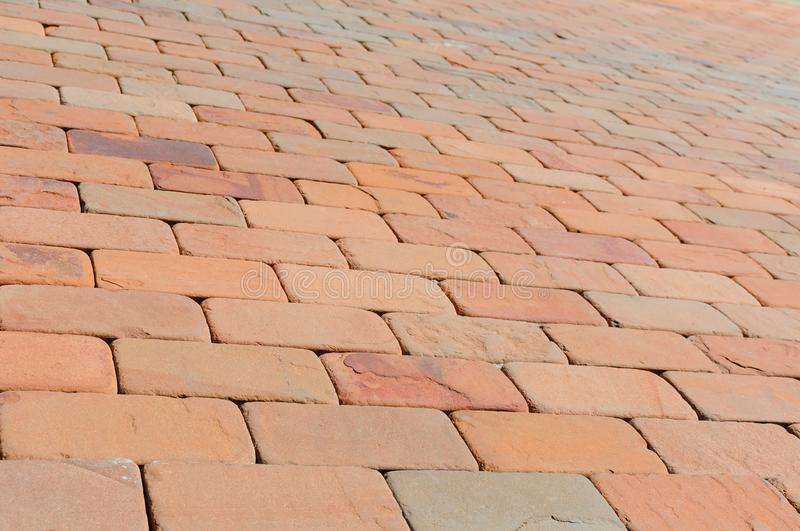 Pavement made of red, dark red and orange bricks royalty free stock image