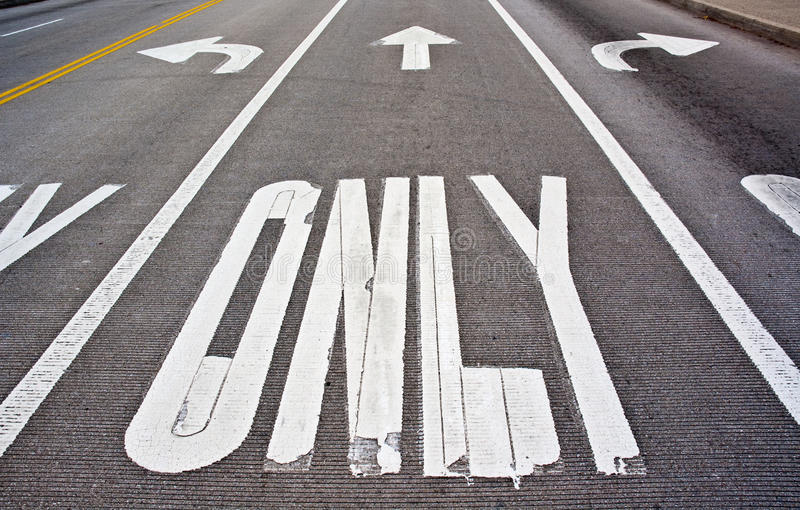 Pavement markings. Three lanes with left only, straight only, right only markings. Can be used as a concept, when dealing with directions royalty free stock photos
