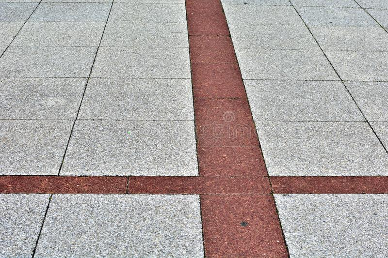 Pavement surface with a red stripe stock image