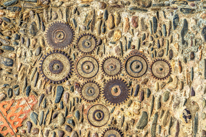 Pavement texture with gears and bricks in Montjuic, Barcelona, S stock image