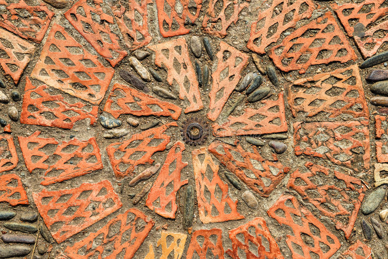 Pavement texture with gears and bricks in Montjuic, Barcelona, Spain. royalty free stock photo
