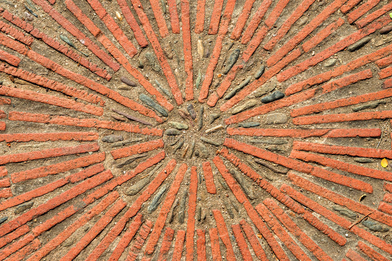 Pavement texture with gears and bricks in Montjuic, Barcelona, Spain. stock image