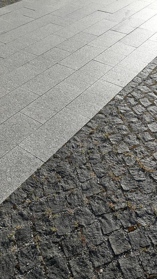 Pavement tiles - combined dark gray and light gray stone tiles stock photo