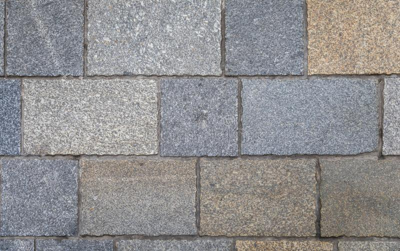 Pavement tiles, texture background. Gray Square Pavement. Seamless Tileable Texture. Old paving tiles background texture royalty free stock photography
