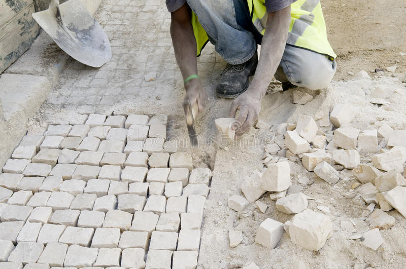 Working Paver - Handcraft - Pavement - Construction royalty free stock image