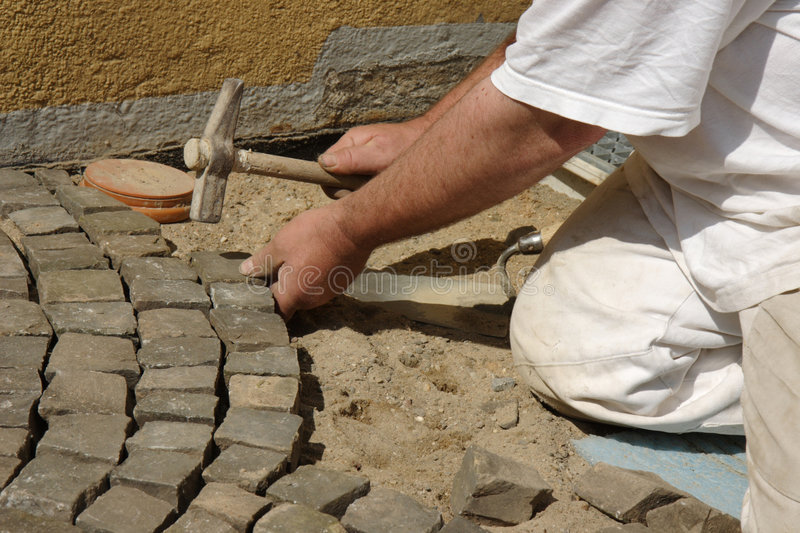 Paver at work stock images