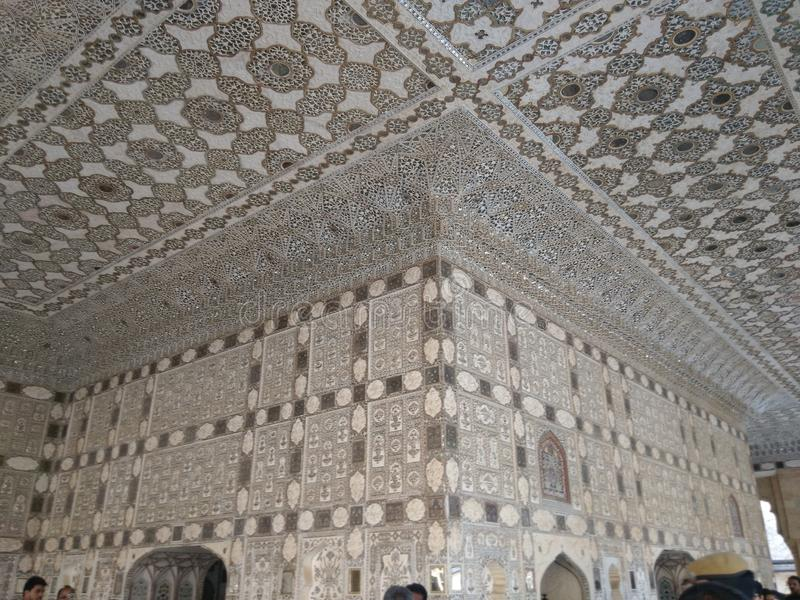 Pavilion in the Amber Fort Sheesh Mahal. Image Shows the walls and ceilings of Sheesh mahal a pavilion in the Amber Fort stock images