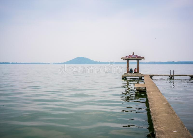 Pavilion at Donghu east lake and Moshan hill in background in Wu royalty free stock photos