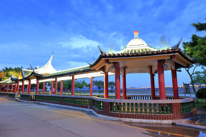 Pavilion at dusk. Pavilion of dragon boat competition pool in jimei town, amoy city, china stock image