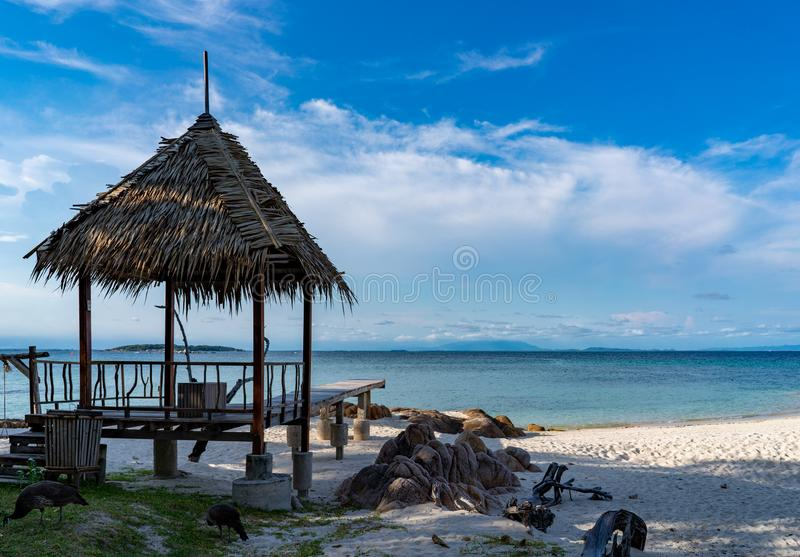 Pavilion made form leaf in vintage and island style settle on the beach with the sea, open sky background, Munnok Island, Thailand royalty free stock image