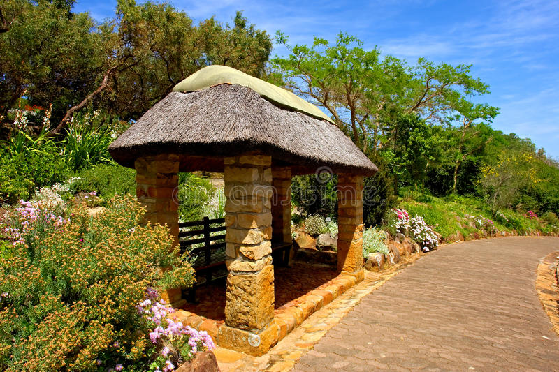 Pavilion with thatch roof. Shot in the Kirstenbosch Botanical Garden, suburb of Cape Town, Western Cape, South Africa stock photography