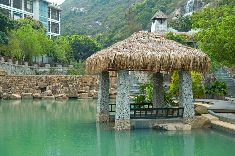 Pavilion with thatch roof. The pavilion with thatch roof beside swimming pool royalty free stock photography
