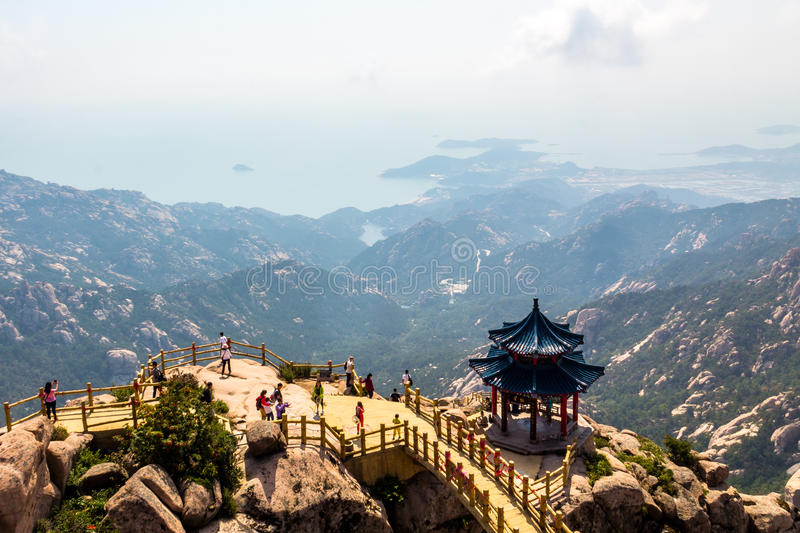 Pavilion on the top of Jufeng trail, Laoshan Mountain, Qingdao, China. Jufeng is the highest trail in Laoshan, where visitors can enjoy beautiful aerial views royalty free stock photos