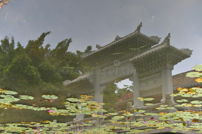 A pavilion under water. You may feel strange about this image, it's abnormal. But if you turn over the picture up side down, then you'll find it's absolutely stock image
