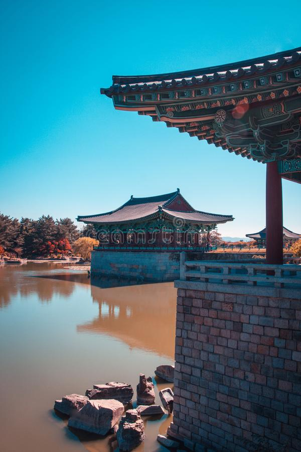 The pavilions of Anapji Pond reflected in the water in Gyeongju, South Korea. Teal and orange view. The pavilions of Anapji Pond reflected in the water in stock image
