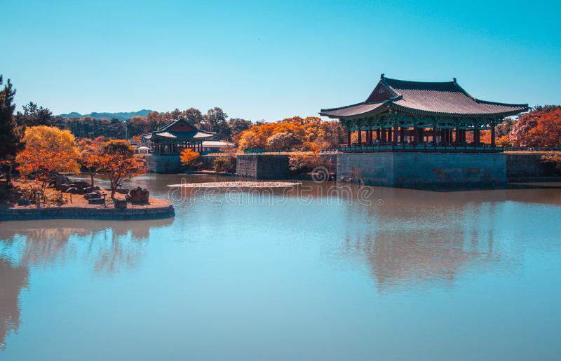 The pavilions of Anapji Pond reflected in the water in Gyeongju, South Korea. Teal and orange view. royalty free stock photography