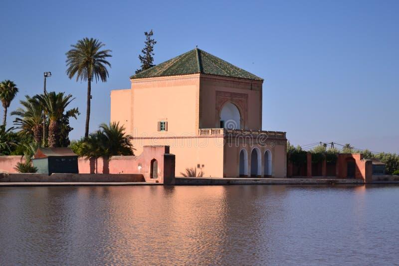 Pavillion in Menara Garden basin, Marrakech. Morocco stock image