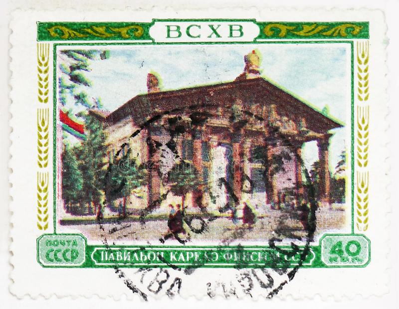 Pavillon of the Karelo-Finnish SSR, All-Union Agricultural Exhibition (BCXB) serie, circa 1955. MOSCOW, RUSSIA - AUGUST 4, 2019: Postage stamp printed in Soviet royalty free stock images