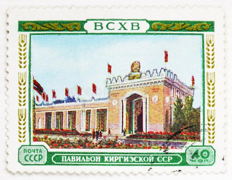 Pavillon of the Kirghiz SSR, All-Union Agricultural Exhibition (BCXB) serie, circa 1955. MOSCOW, RUSSIA - AUGUST 4, 2019: Postage stamp printed in Soviet Union ( stock images