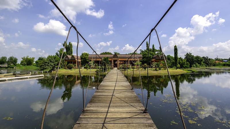 A pavillon at the lake near the Sai Ngam Bayan Tree in the Town of Phimai in the Provinz Nakhon Ratchasima. In Isan in Thailand royalty free stock images