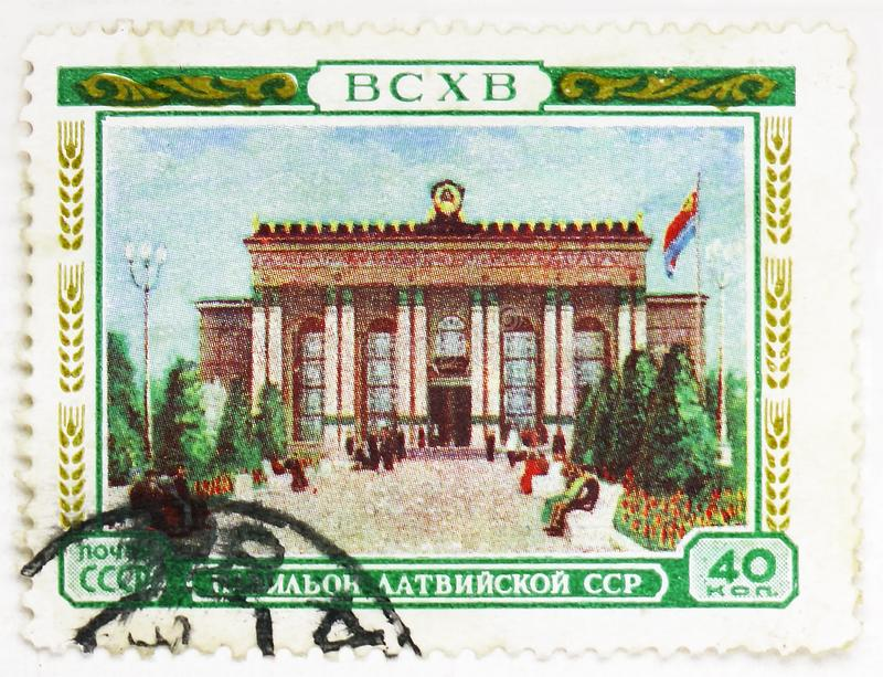 Pavillon of the Latvian SSR, All-Union Agricultural Exhibition (BCXB) serie, circa 1955. MOSCOW, RUSSIA - AUGUST 4, 2019: Postage stamp printed in Soviet Union ( stock images