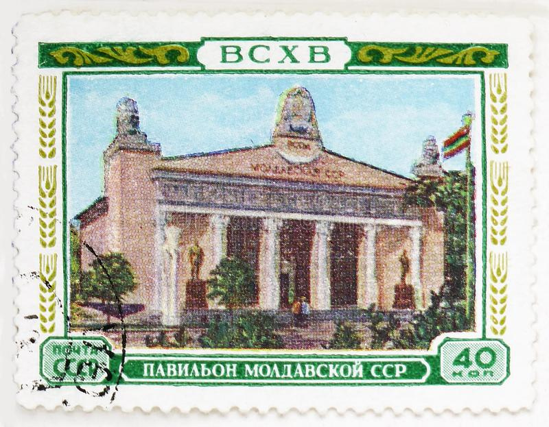 Pavillon of the Moldavian SSR, All-Union Agricultural Exhibition (BCXB) serie, circa 1955. MOSCOW, RUSSIA - AUGUST 4, 2019: Postage stamp printed in Soviet Union royalty free stock photography