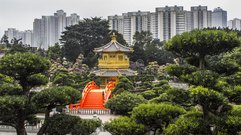 Pavillon in Nan Liang Garden, Hong Kong. A pavillon located in Nan Liang Garden in Hong Kong, surrounded by one of the densely populated urban regions of the stock images