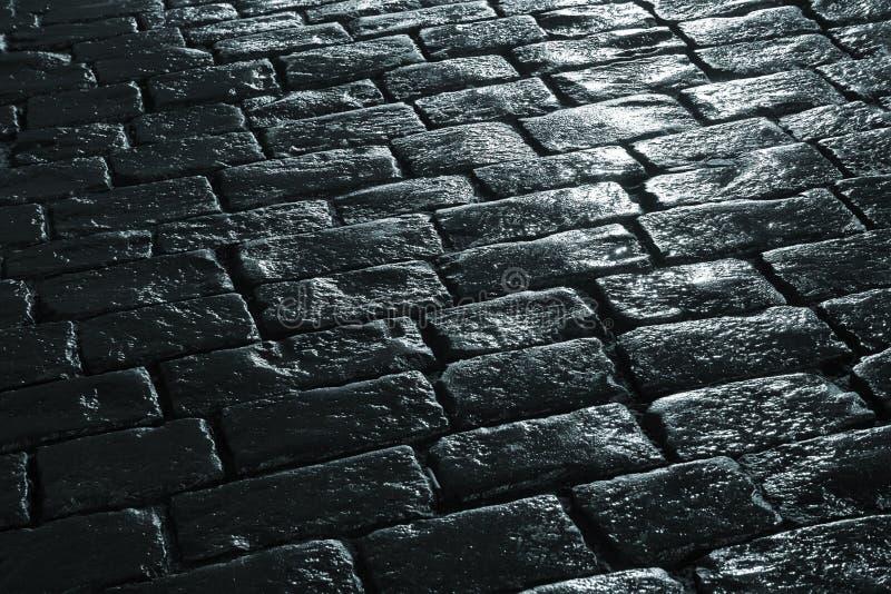 Pavimentazione bagnata fotografie stock