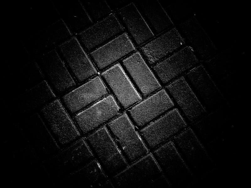 Pavimentazione del fondo nero di struttura del contesto di colore fotografia stock libera da diritti