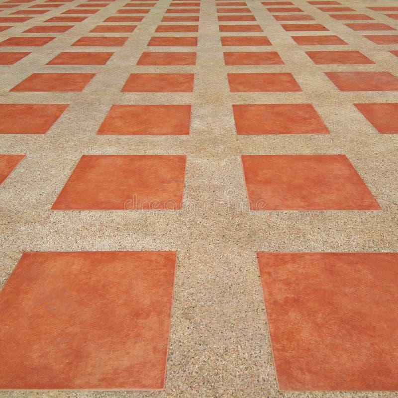 Pavimentazione in piastrelle arancio immagini stock libere da diritti