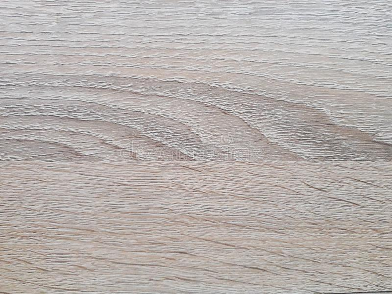 Pavimenti di legno della luce del fondo ed inserzioni marroni immagine stock