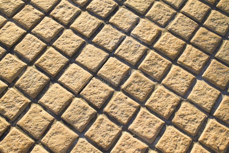 Pavimento amarelo do assoalho do tijolo foto de stock royalty free