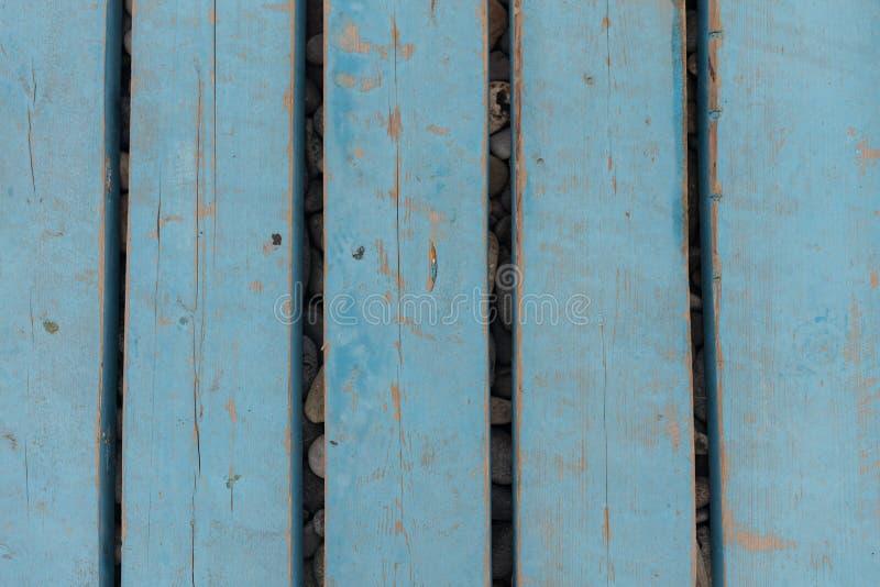 Pavimento de madeira feito de tábuas na costa Textura de fundo em madeira de vindima com nós e orifícios Conceito de projeto foto de stock