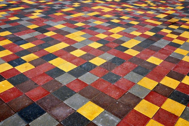 Pavimento de tejas concretas cuadradas fotografía de archivo libre de regalías