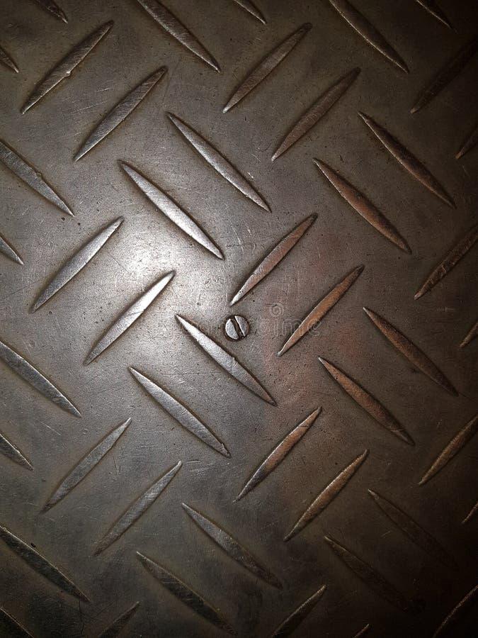 pavimento del metallo con una superficie sollevata fotografie stock libere da diritti