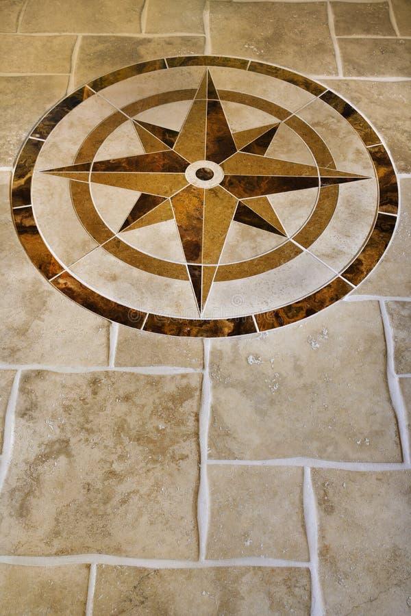 Pavimento di marmo con figura della stella. fotografia stock
