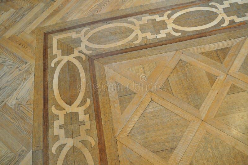 Pavimento di parchè di legno dell'intarsio immagini stock