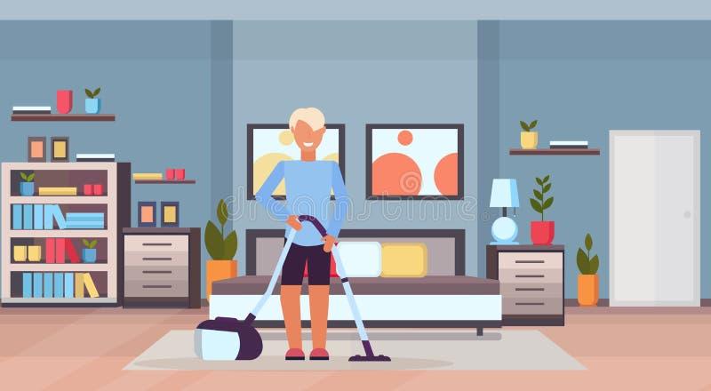 Pavimento di pulizia della camera da letto dell'uomo con il tipo dell'aspirapolvere facendo uso dell'interno domestico moderno de illustrazione vettoriale