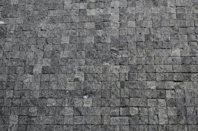 Pavimento di una via con le mattonelle di pietra fotografia stock
