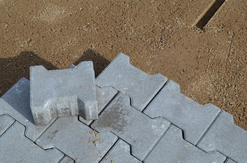 Paving at a construction site. Paving with precast concrete paving stones stock photo