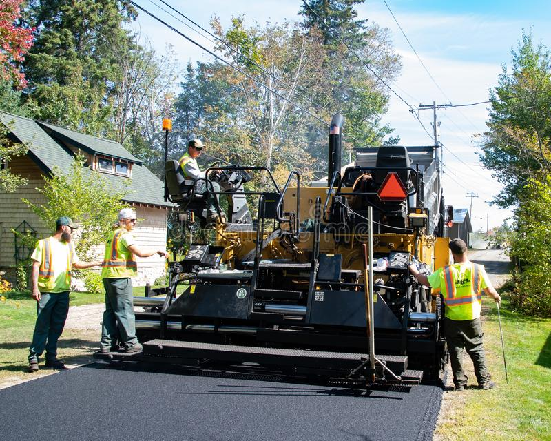 Paving crew and machine stock photography