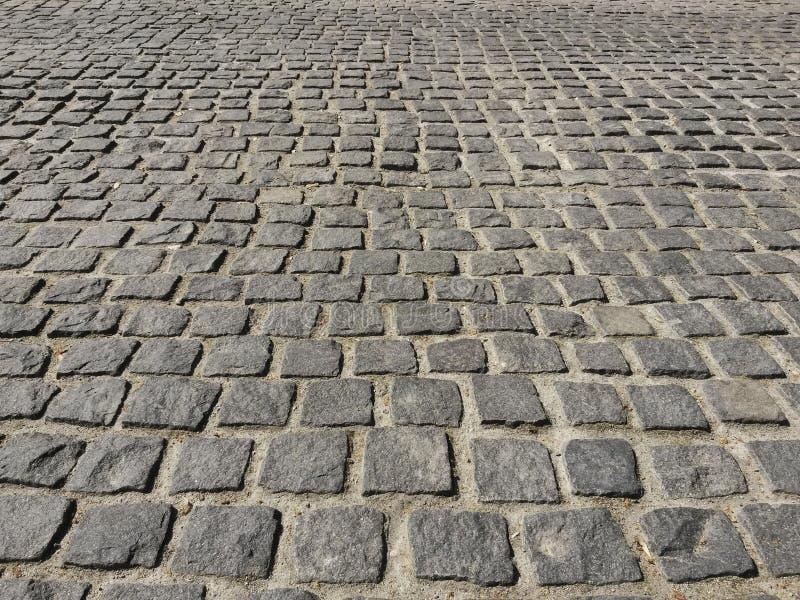 Paving. Floor of granite paving stone stock photos